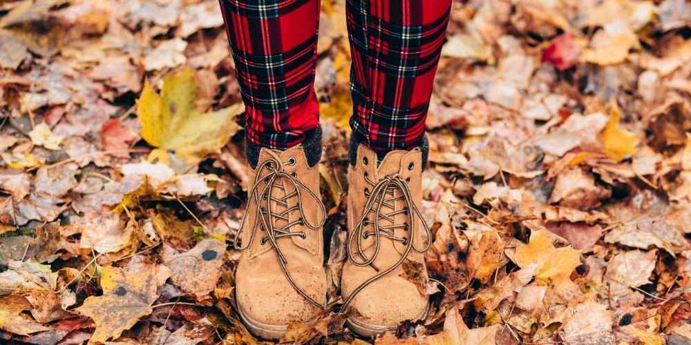 Fashionable Work Boots Crunching in Dried Maple Leafs